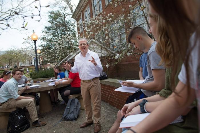 A Marietta College professor teaches outside