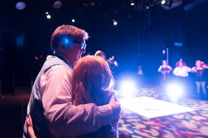 Two actors hold eachother at a theatre production at Marietta College