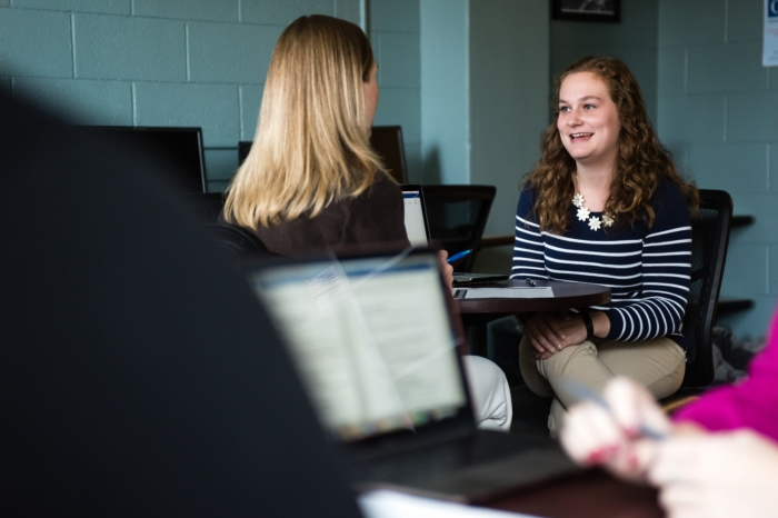 Marietta College student talks to a Communication professor