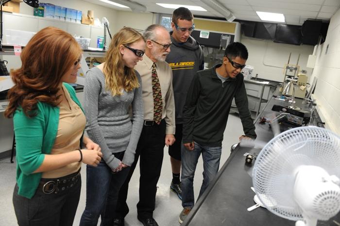 students observing experiment