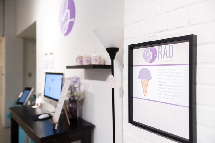 A senior art exhibition at Marietta College shows off a branding suite created by a senior student