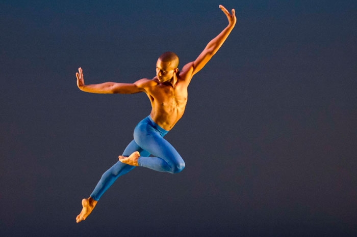 Male dancer gliding across the stage