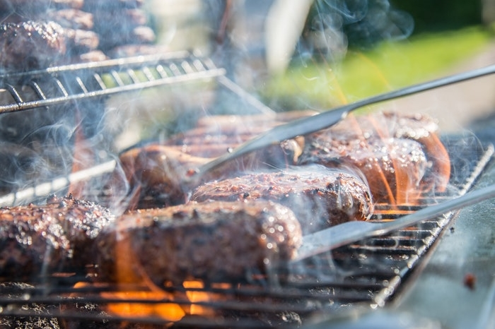 Close up of hamburgers on a grill