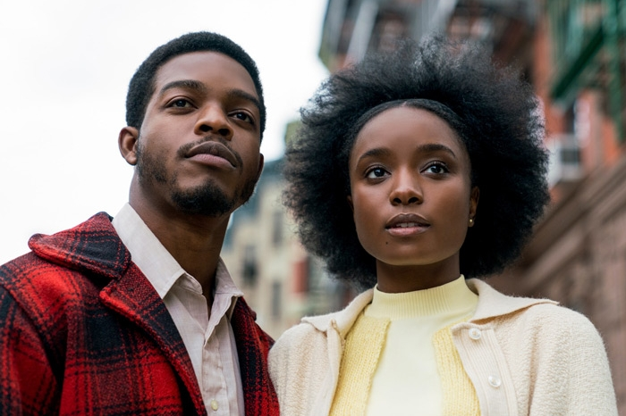 African-American man and woman looking straight ahead