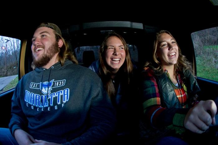 Three Marietta students driving in a Jeep Wrangler