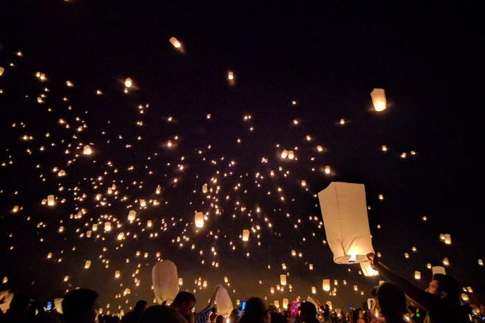 Chinese lanterns being released into the sky