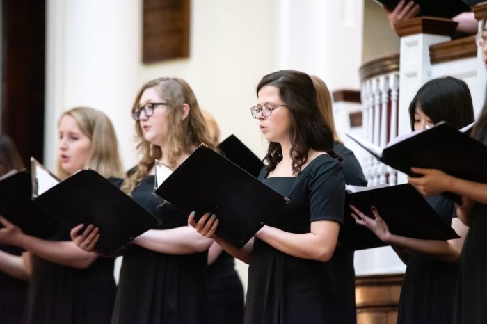 Female students singing in the choir