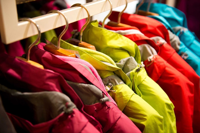 Pink, yellow and red coats hanging