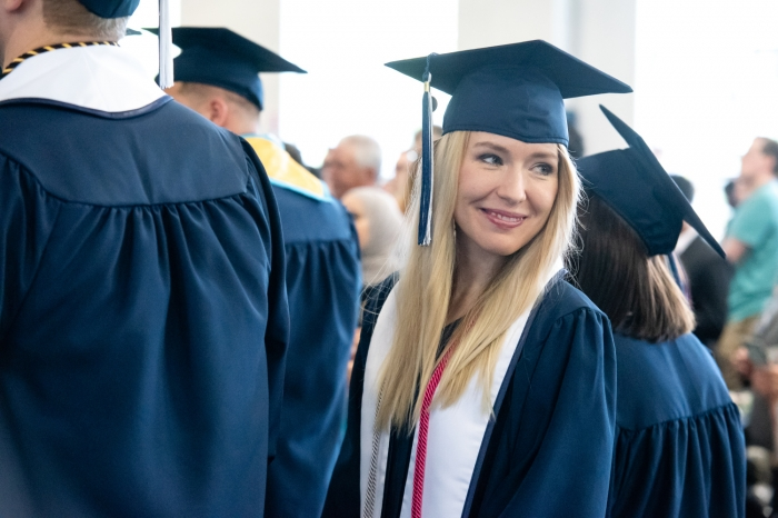 Female student ready for graduation to begin