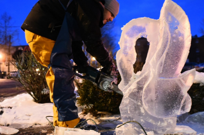 Man carving ice