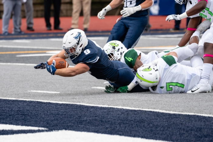 Running back Tanner Clark diving for the end zone