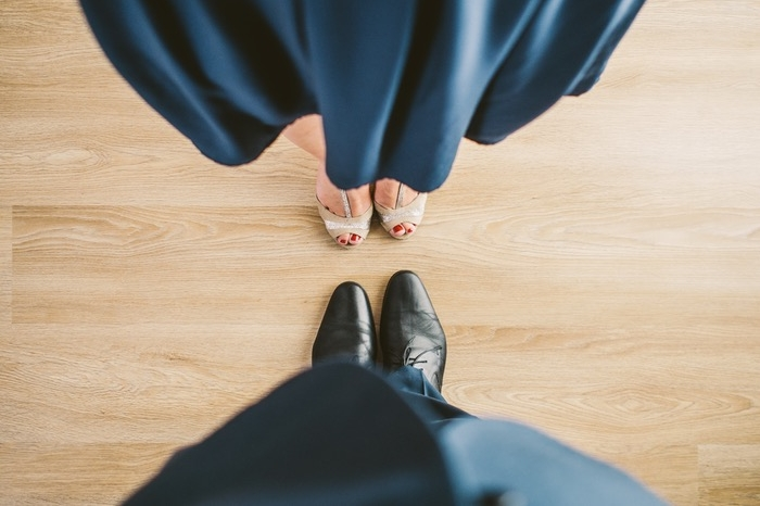 looking down on formal shoes of couple