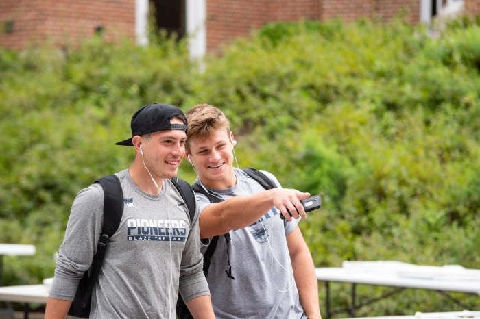 Two male students at the campus Involvement Fair