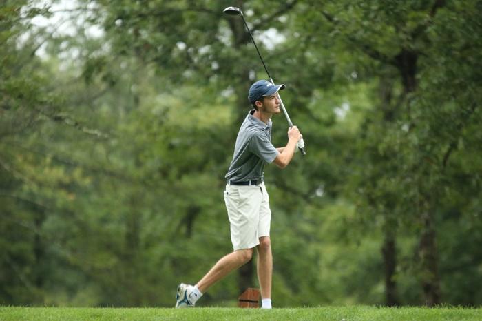 Men's golfer watching his shot
