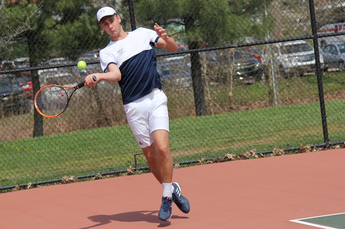 Men's tennis player returning a shot