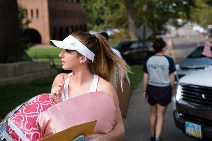 Female student wearing a visor on move-in day