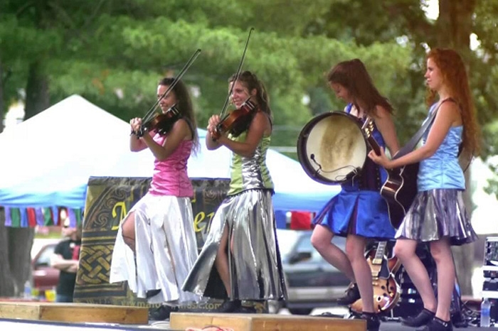 Women performing on string instruments at Multicultural Festival