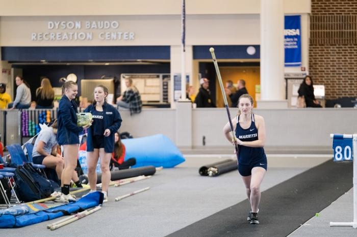 Female athlete running for the pole vault