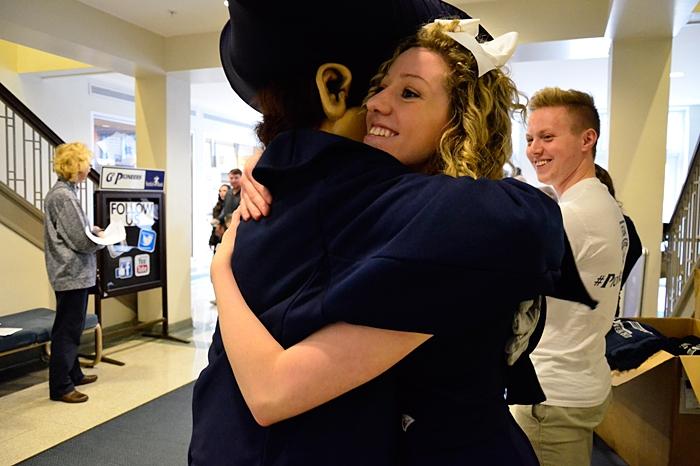 Putnam hugging a student