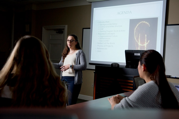 Female student making a presentation in class