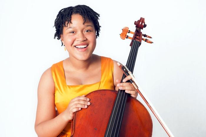 Sujari Britt, young girl holding a cello