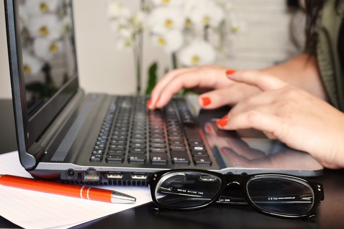 woman's hands on keyboard typing
