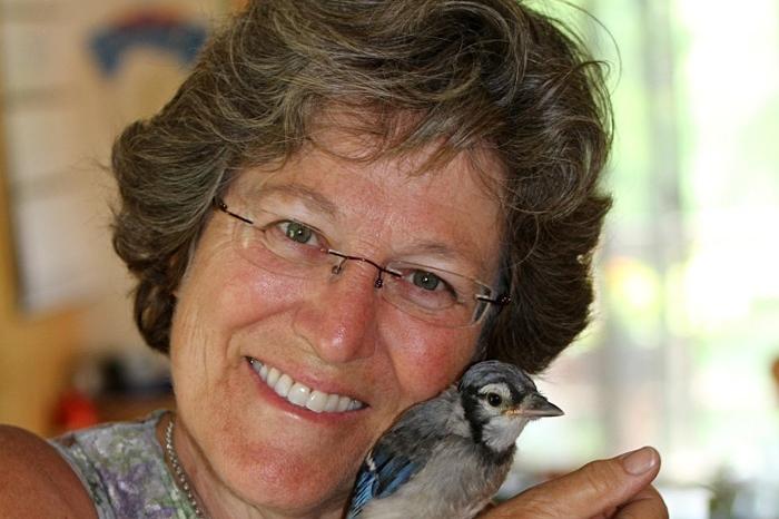 Julie Zickefoose holding a bird