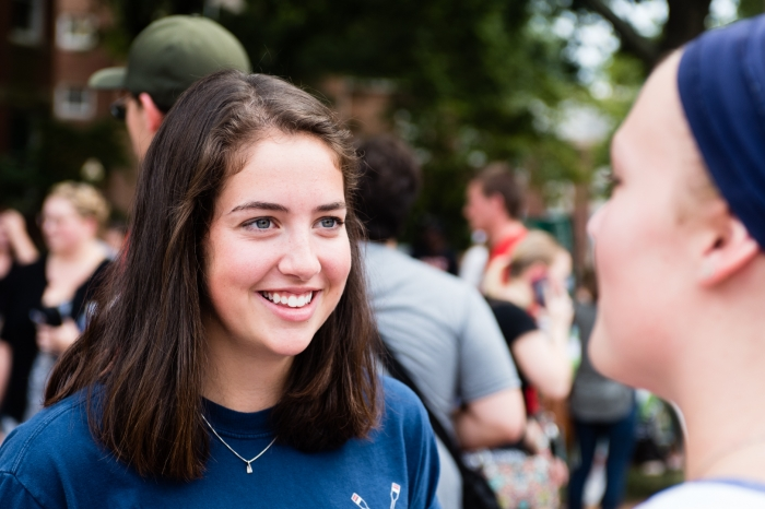 Female Marietta College student at the involvement fair smiles at her friend
