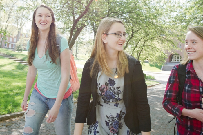 Three students walking on the Mall