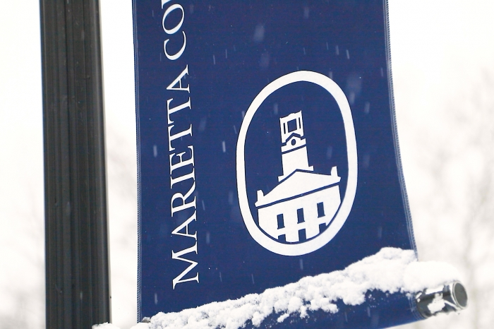 Marietta College blue banner with snow covering it