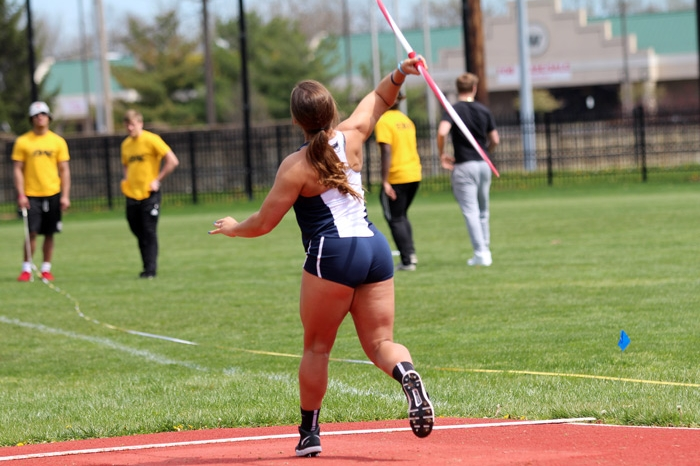 Female track athlete throwing the javelin