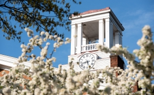 Erwin Tower at Marietta College framed by white flowers