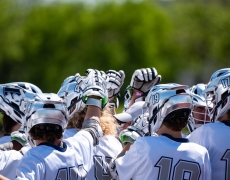 Lacrosse players huddled up before game