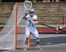 Men's lacrosse goalie making a play