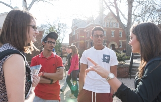 Students talk outside of Gilman