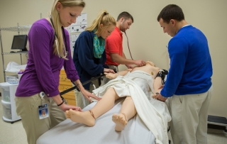 students practicing medical treatment