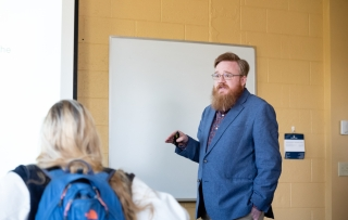 Male professor teaching in front of the class