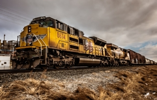 Yellow train on a railroad