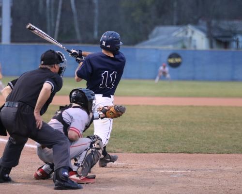 Baseball player following through on a swing