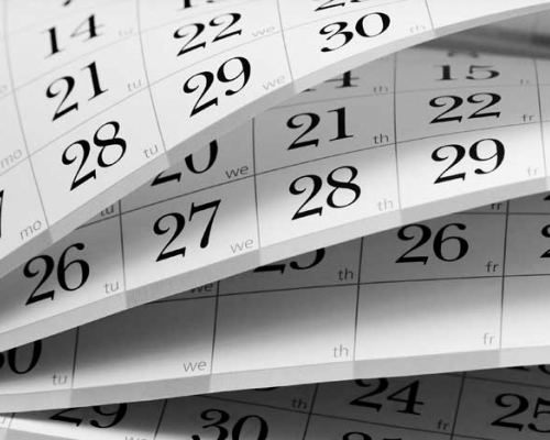 desk calendar being flipped to next page