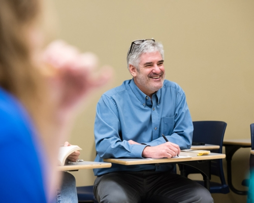 Professor Tim Catalano sitting in a classroom