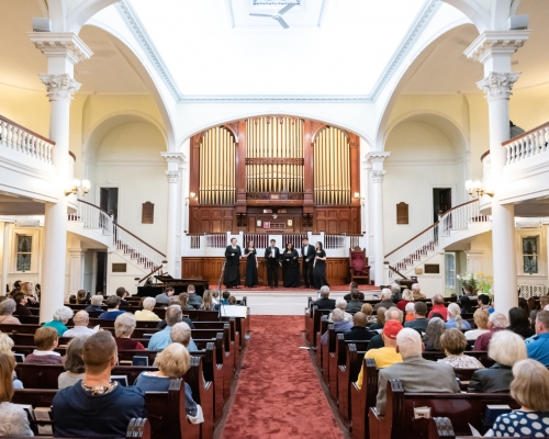 Wide shot from inside church during concert