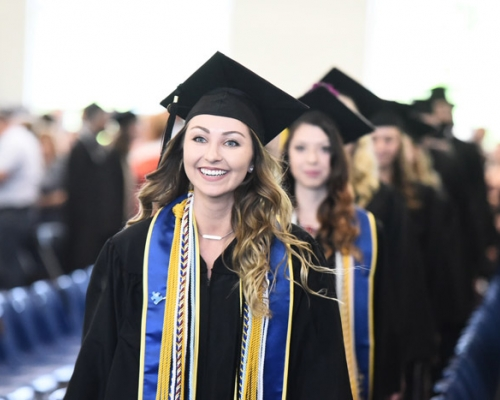 female student entering commencement
