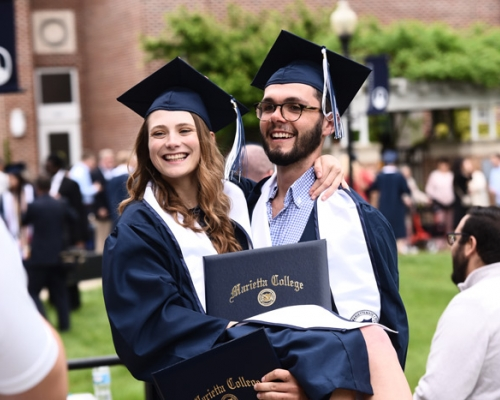 Marietta College graduates celebrate following the Commencement ceremony