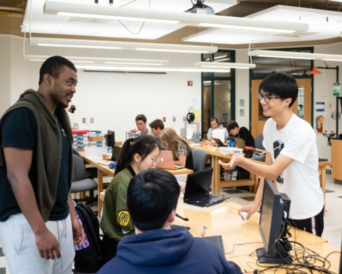 Students speaking while working on a class project