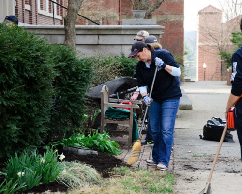 Employees and students cleaning campus