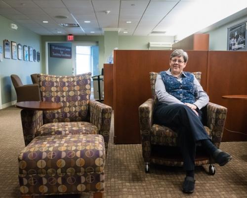 Debbie Egolf sitting in the Worthington Center