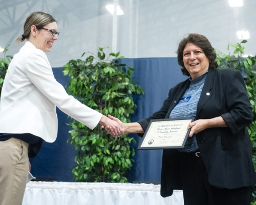 Tina Thomas receiving an award for advising during Founders Day 2018