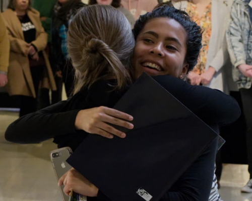 France Moise '20 hugs Professor Beth Nash
