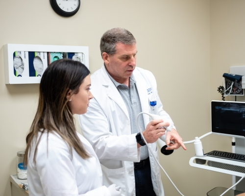Dr. John Grosel demonstrates how to use an ultrasound machine